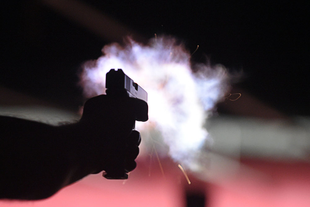 3b3822a0e70d5 Detail photo of a Glock .40-caliber handgun being fired at the Northeast  District police station's qualification range. SEE MORE PHOTOS